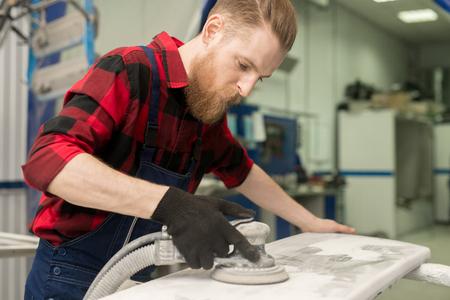 Technician Polishing Vehicle