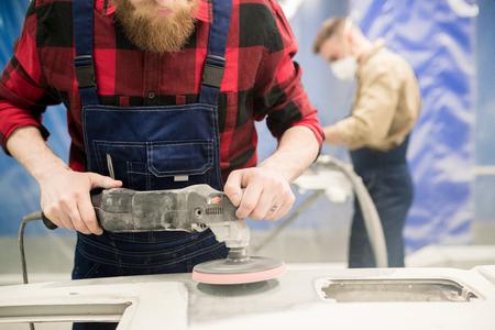 Repairmen Polishing Auto Parts Stock Photo