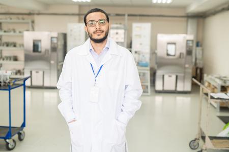 Confident Arabian engineer working in innovative plant Banco de Imagens
