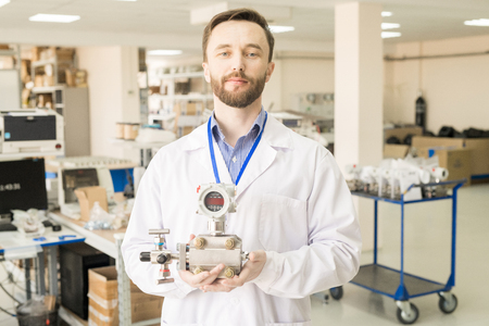 Content engineer holding manometer in quality control office Stock Photo