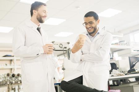 Jolly factory lab staff enjoying coffee break