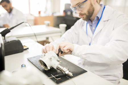Concentrated technician finding out reason of transducer breakdo