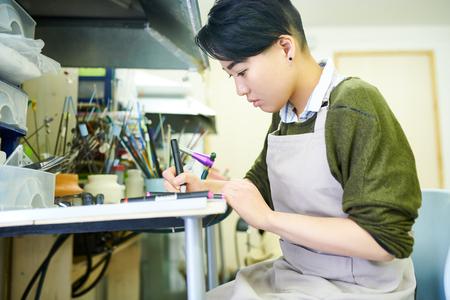 Asian Artist Drawing