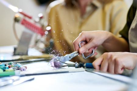 Artist Breaking Glass Ball Stock Photo