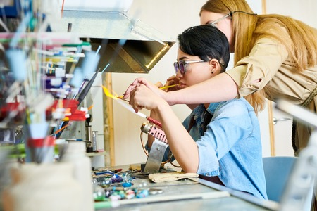 Two Female Artists Collaborating in Glassworking Studio Stock Photo