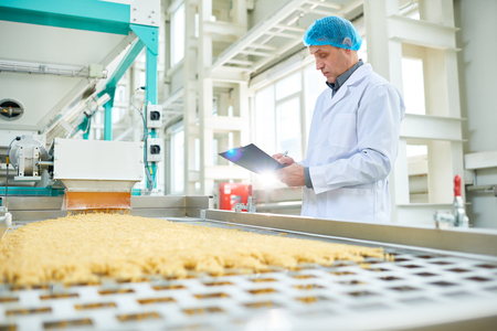 Senior Worker at Food Factory Stock Photo