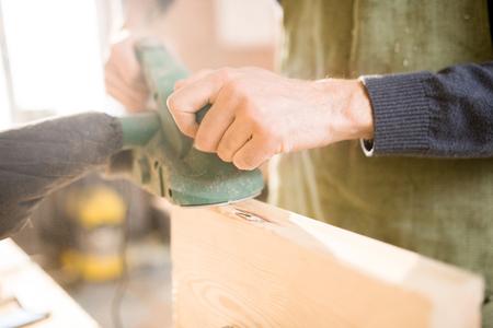 Handsome Carpenter Working in Sunlight Stock Photo