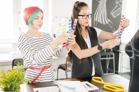 Two Creative Designers Working in Atelier