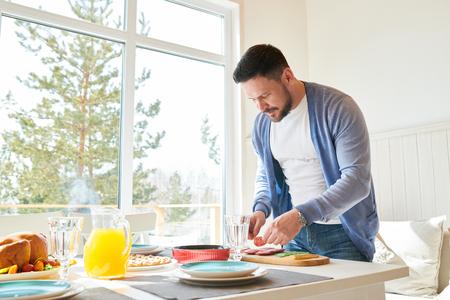 Mature Man Preparing Family Dinner 写真素材