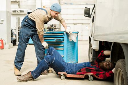 Technicians Repairing Truck