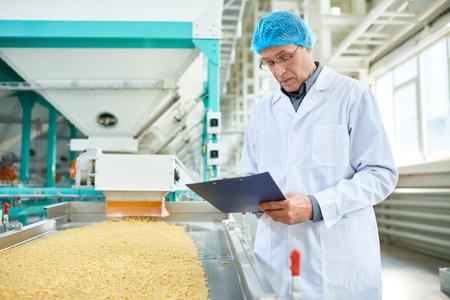 Senior Man Working at Food Factory