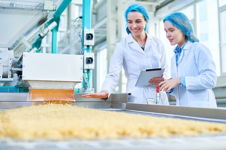 Young Women Working at Food Factory