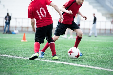 Two Kids Playing Football