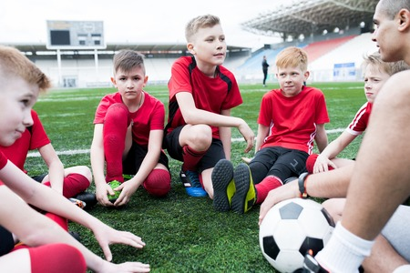 Group of Boys Listening to Coach Stock Photo