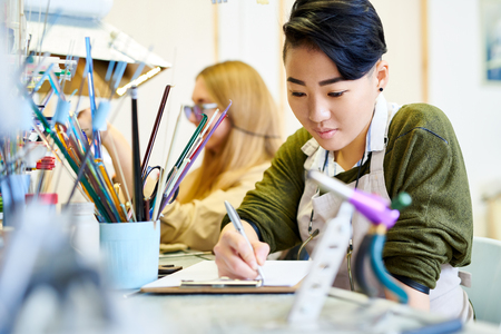 Creative Woman Drawing in Workshop Stock Photo