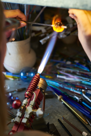 Female Artist Shaping Glass Beads in Gas Flame