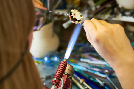 Unrecognizable Artist Shaping Glass in Flame Stock Photo