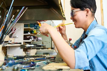 Asian Artist Shaping Glass Stock Photo
