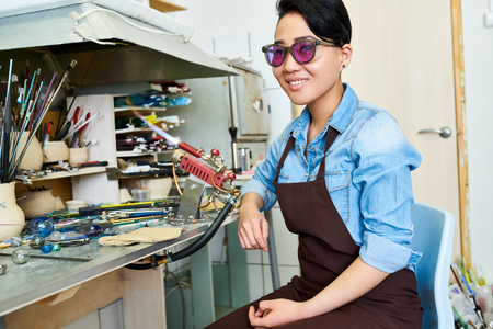 Successful Asian Artist in Glassworking Studio