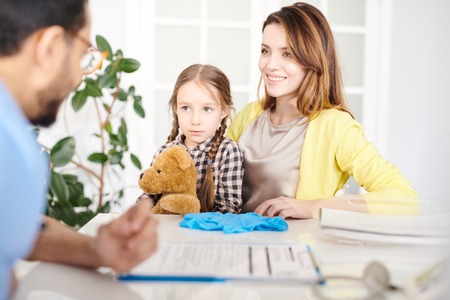 Little Girl Visiting Doctor with Mom