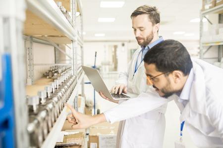 Examining Quality of Measuring Equipment Stock Photo