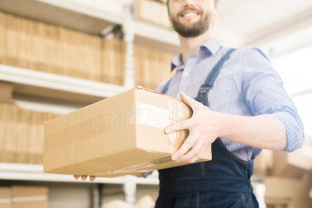 Warehouse Worker Carrying Cardboard Box Stock fotó