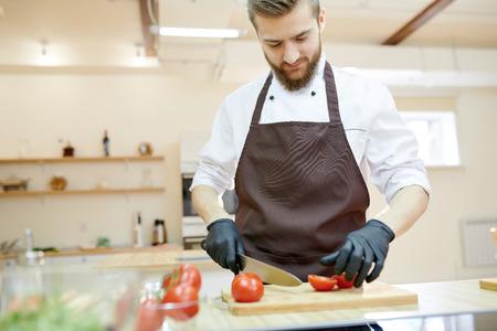 Professional Chef Cooking in Restaurant Banco de Imagens