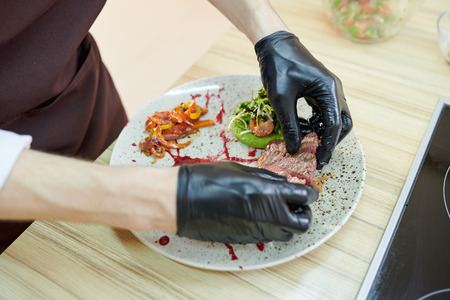 Chef Plating Meat Stock Photo