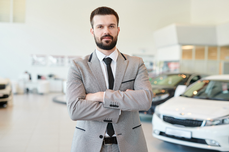 Mature Businessman Posing in Car Showroom Zdjęcie Seryjne