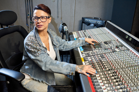 Professional woman in sound studio