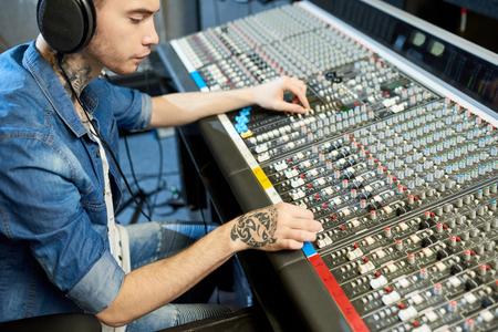 Man creating music in recording studio Banco de Imagens