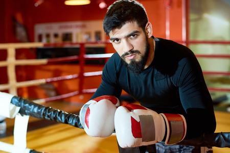 Handsome brutal boxer on ring