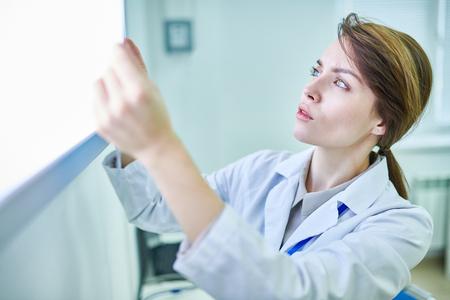 Doctor holding something and examining it