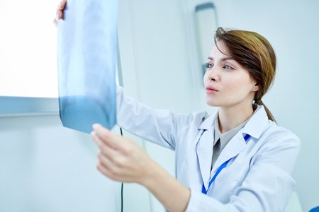 Doctor looking attentively at X-ray of chest Stock Photo