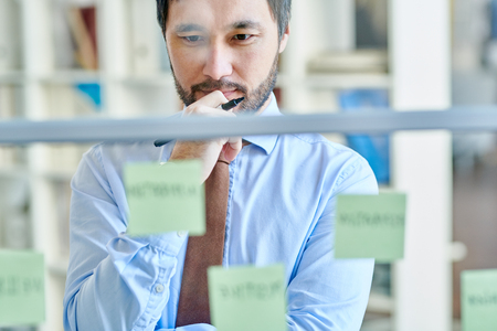 Thoughtful man creating new strategy