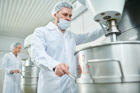 Side view of sweet production in light factory Stock Photo