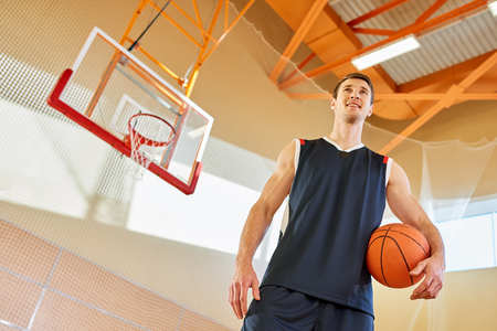 Smiling man on basketball court