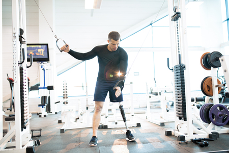 Adaptive Athlete Using Exercise Machines in Gym