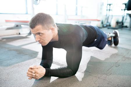 Adaptive Sportsman Exercising in Gym Stock fotó