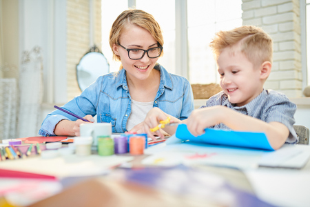 Mother and Son Crafting Together at Home