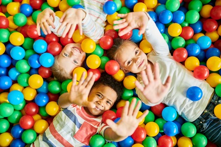 Three Kids Playing in Ballpit