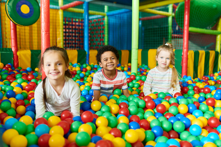 Three Cute Kids Playing in Ballpit Stok Fotoğraf - 104024555