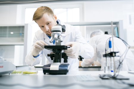 Scientist Using Microscope in Lab