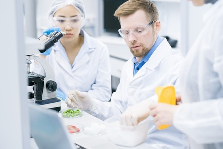 Team of Scientists Doing Research in Laboratory