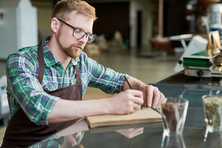 Barista Writing Blends of Coffee