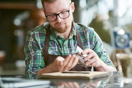 Modern Barista Examining Coffee Beans