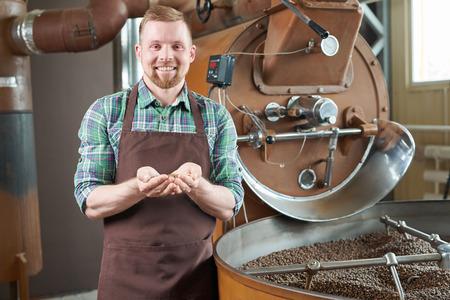 Coffee Roaster Posing by Machine