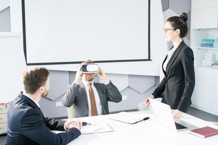Businessman Enjoying VR Headset in Meeting 写真素材