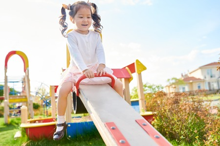 Cute Asian Girl on Playground Stockfoto