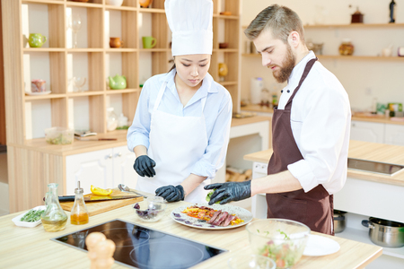 Two Chefs Working on Dishes Stock Photo